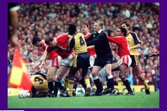Football - English Division 1 - Manchester United v Arsenal - Old Trafford - Manchester - 20/10/90 A 21-man brawl broke out after Arsenal's Nigel Winterburn and Anders Limpar had gang-tackled Manchester's Denis Irwin. Arsenal were deducted two points, United one  Mandatory Credit: Action Images / MSI  PLEASE NOTE: FOR UK EDITORIAL SALES ONLY. CONTRACT CLIENTS: ADDITIONAL FEES MAY APPLY - PLEASE CONTACT YOUR ACCOUNT MANAGER
